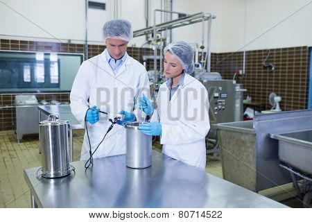 Focused biologist team working together in the factory