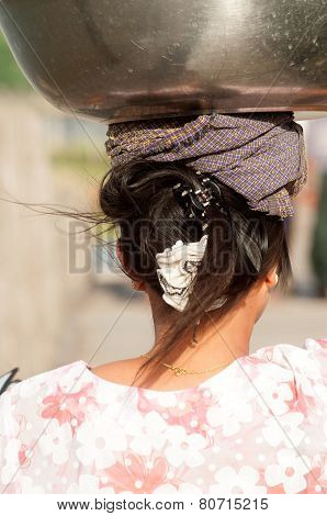 Myanmar Woman Carrying On Her Head