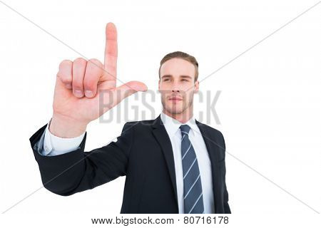 Unsmiling businessman in suit pointing up his finger on white background
