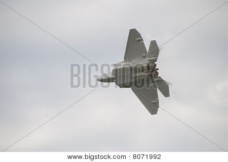 Bottom of F22 Raptor jet airplane with Afterburners glowing red