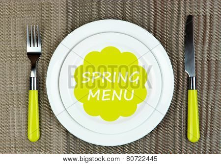 Plate with text Spring Menu, fork and knife on tablecloth background