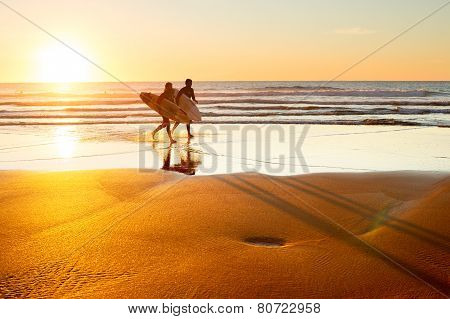Surfers At Sunset, Portugal