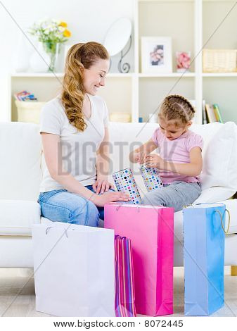 Mother With Daughter Openning Gift