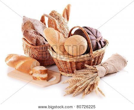 Different bread in wicker baskets isolated on white