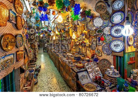 JERUSALEM, ISRAEL - JULY 10, 2014: Typical gift shop with variety of traditional middle eastern handmade souvenirs popular with tourists and pilgrims visiting Old City of Jerusalem.