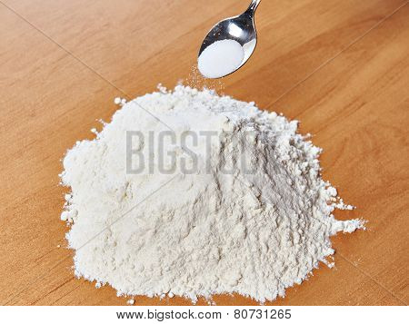 Flour With Salt And Spoon On Table
