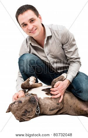 Happy man with a pitbull puppy