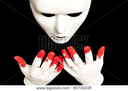 White theatrical mask and blood on their hands