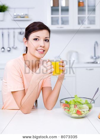 Woman With Fresh Orange Juice