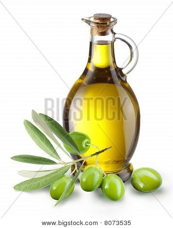 Branch with olives and a bottle of olive oil