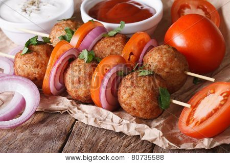 Meatballs On Skewers With Onions And Tomatoes.  Horizontal