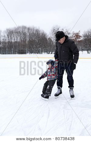 Grandfather Teaches His Grandson To Skate
