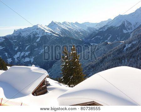 Ski huts in alpine winter landscape