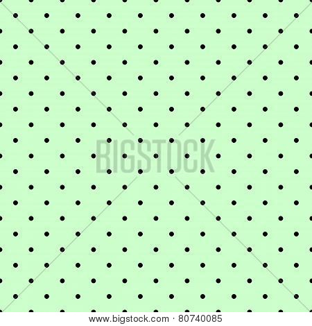 Tile vector pattern with black polka dots on mint green background