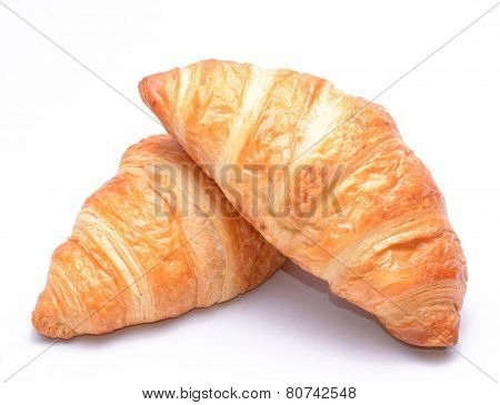 Fresh and tasty croissants on white background