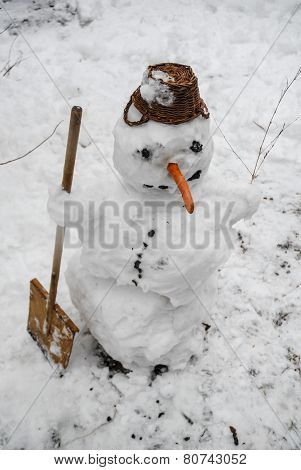 Smiling snowman standing in the snow