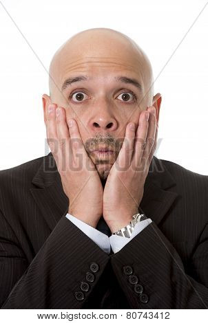 Surprised Hispanic Businessman In Suit And Tie Looking Scared, Shocked And Confused With Hands On Hi
