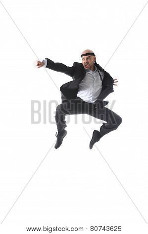 Spectacular Aggressive Businessman Jumping On The Air In Kung Fu Fist Or Karate Flying Punch Attack