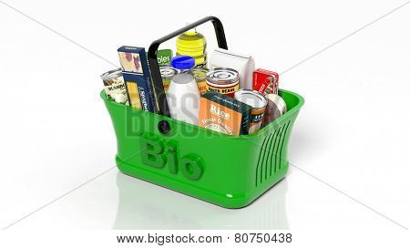 Green shopping hand basket with organic groceries isolated on white