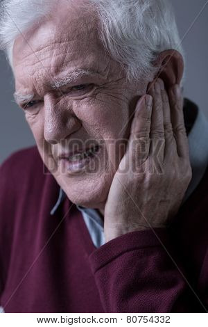 Senior Man Having Toothache