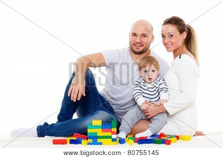 Happy Family With  Baby Build House.