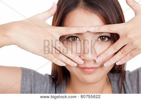 Young Asian Woman Smile Peeking Though Her Fingers
