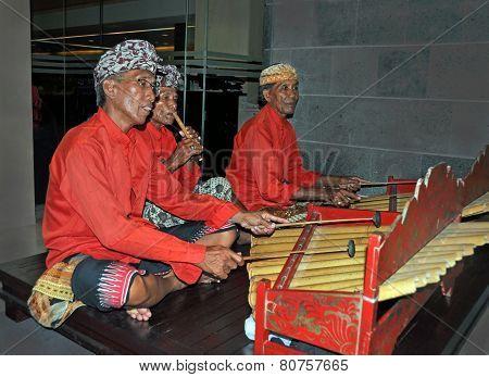 Gamelan Jegog Trio Performing In Bali, Indonesia.