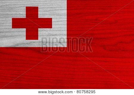 Tonga Flag on wood background