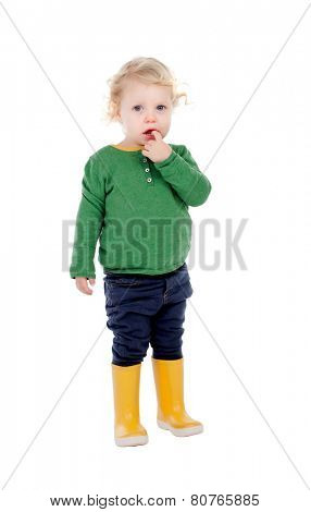 Adorable baby with yellow gumboots isolated on a white background