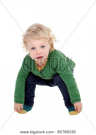 Adorable blond baby touching his feet isolated on a white background