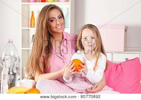 Mother Giving Fruit To Child