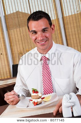man eating dessert
