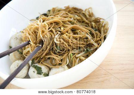 Chopsticks On Asian Noodle