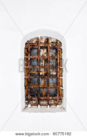 Old fort castle lattice window in white wall