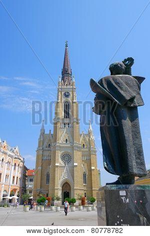 NOVI SAD, SERBIA - AUGUST 02: the Catholic Cathedral and the statue Svetozar Miletic in main square of Novi Sad. Shot in 2014