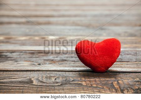 Love heart on breakage wood texture background, valentines day card concept