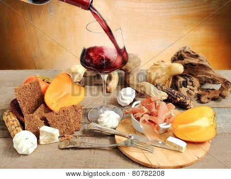 Wine Tasting With Persimmon, Meringue, Parma Ham, Cereal Bread And Autumnal Decorations