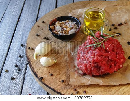 Raw ground beef for burgers cooking with spices