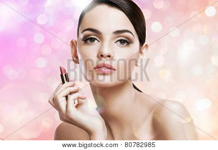 Charming young lady with lipstick