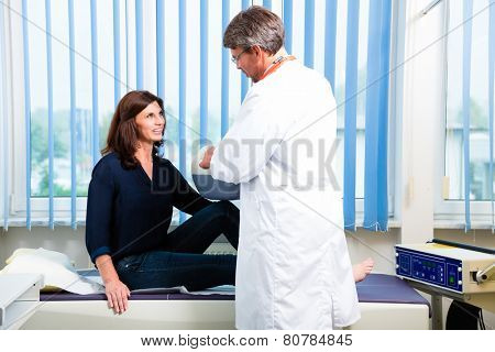 Orthopedist doctor making ultrasonic image on patient in surgery