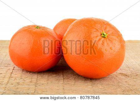 Studio Shot Mandarines,tangerines Isolated On Wooden Table