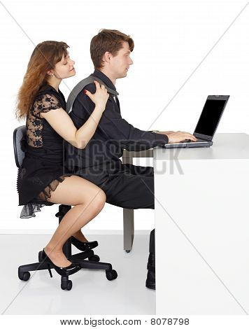 Funny Man And Woman Sitting At The Table
