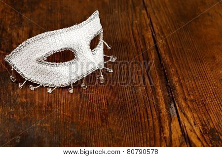 White Mask On Wooden Table