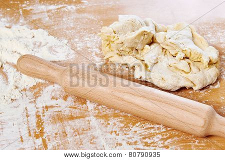 Rolling Pin And Dough On Kitchen Table