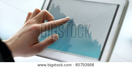 close up hands woman using tablet with business document