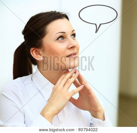 Thinking woman with idea in empty bubble looking up with fingers at face