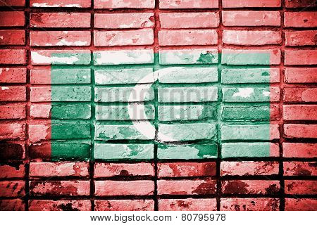 Maldives Flag painted on grunge wall