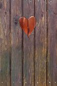 picture of wooden shack  - Wooden board with cut out heart shape - JPG