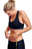 pic of measurement  - Woman taking waist measurement with tape for thin weightloss healthy slimming diet isolated - JPG