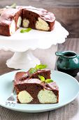 stock photo of cake-ball  - Chocolate cake with coconut cheese balls on plate - JPG